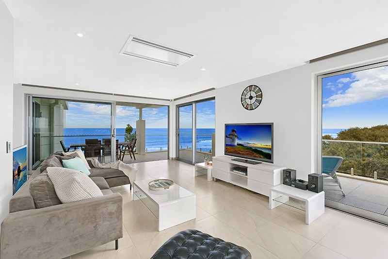 The Entrance North Real Estate: BREATHTAKING BEACHFRONT APARTMENT